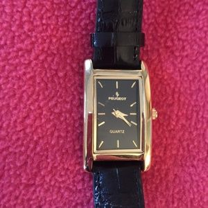 Peugeot gold tone watch